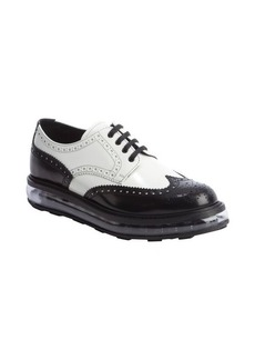 Prada black and white shined leather clear midsole lace-up oxfords