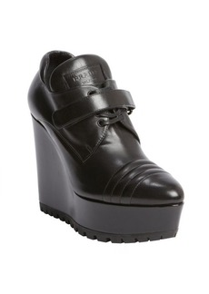 Prada black leather wedge ankle boots