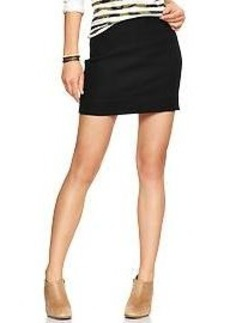 Zip-back tweed mini skirt