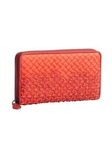 Bottega Veneta red intrecciato ripped fabric and leather zip continental wallet