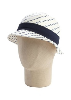 Calvin Klein navy and white woven straw cloche