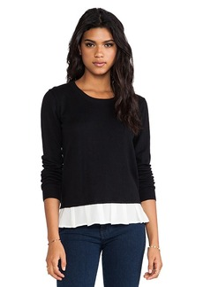 Central Park West Rye Ruffle Trim Sweater in Black