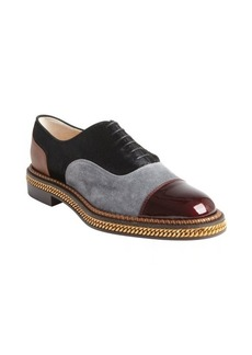 Christian Louboutin black, grey, and rouge fur, suede and leather oxfords