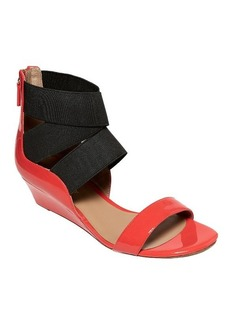 Delman Stretch out the Summer with this Low-Wedge Sandal