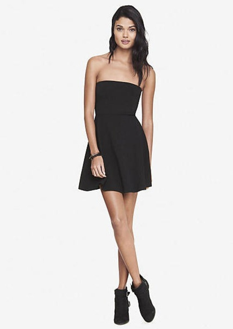 A flattering twist on a classic shape, this strapless midi dress features a gathered frill from the neckline for a flattering shape and unique aesthetic.