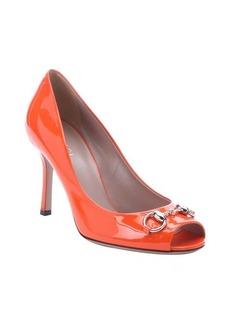 Gucci orange patent leather 'Jolene' horsebit peep toe pumps