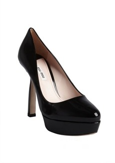 Miu Miu black patent leather notched heel platforms