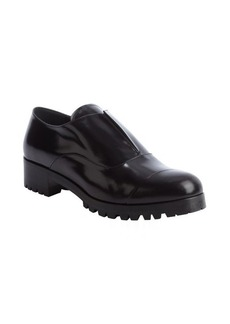 Miu Miu black shined leather laceless oxfords with lug sole