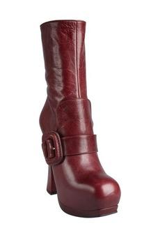 Miu Miu brick leather flap buckle strapped platform boots