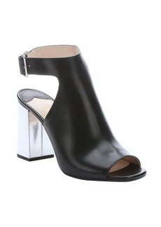 Prada black and silver leather ankle strap mules