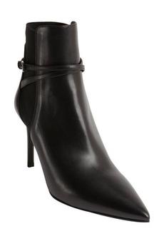 Prada black leather pointed toe wraparound bucklestrap booties