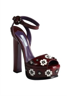 Prada maroon leather and floral applique stacked heel platforms