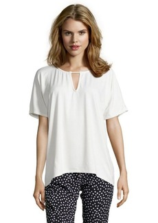 Three Dots gardenia jersey knit hi-low piping trim top