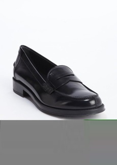 Tod's black leather penny strap loafers