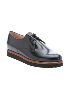Tod's black leather rubber soled lace-up oxfords