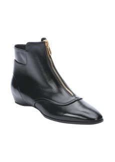 Tod's black patent leather hidden wedge ankle boots