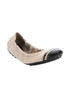 Tod's nude and black leather beaded captoe packable flats