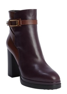 Tod's raspberry and brown leather heeled platform ankle boots