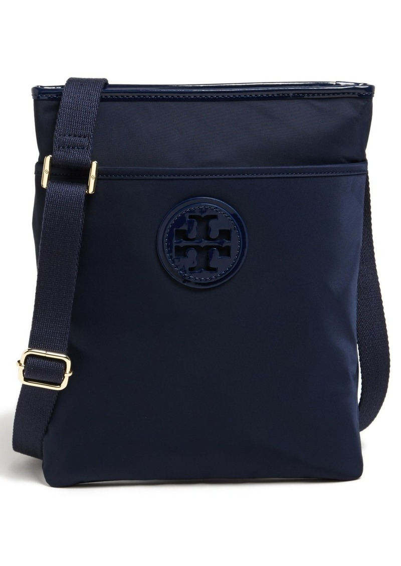 Product Description or tuck into a pocket, this Tory Burch wallet is a petite style that.