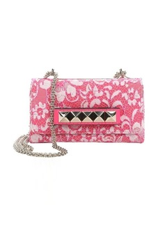 Valentino fuchsia lace-covered leather-studded shoulder bag